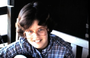 Me playing the guitar at 10 years old... with my giant glasses.