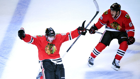 Jun 8, 2013; Chicago, IL, USA; Chicago Blackhawks right wing Patrick Kane (88) celebrates with center Andrew Shaw (65) after scoring the game-winning goal during the second overtime in game five of the Western Conference